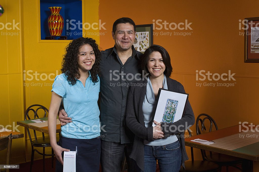 family owners of restaurant royalty free stockfoto