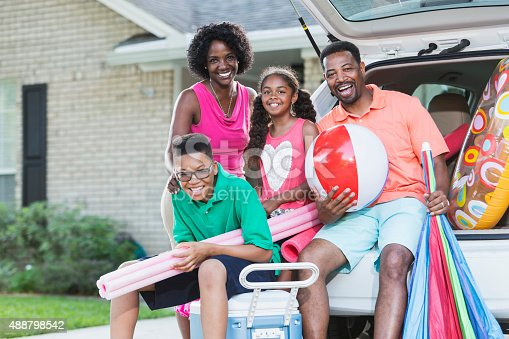 807410158 istock photo Family packing car for trip to the beach or pool 488798542