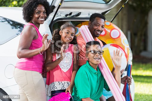 807410158 istock photo Family packing car for trip to the beach or pool 489427982