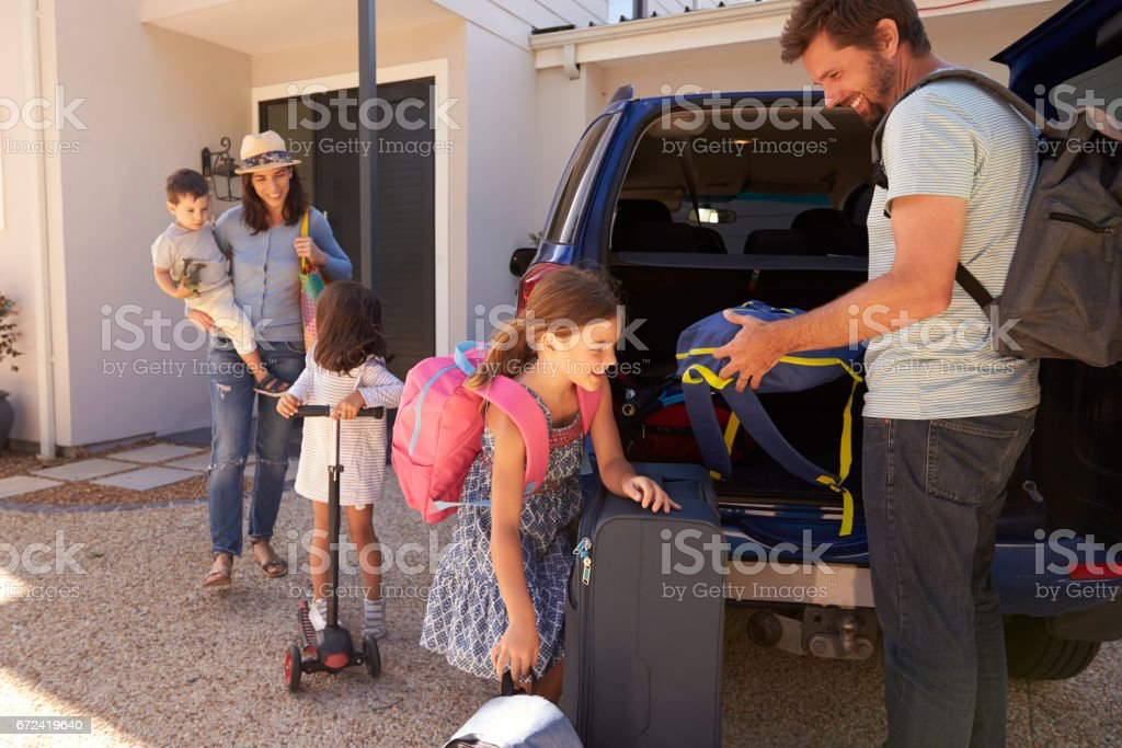 Family Packing Car Ready For Summer Vacation stock photo
