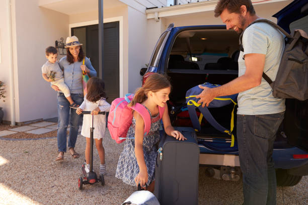 family packing car ready for summer vacation - family vacation stock photos and pictures