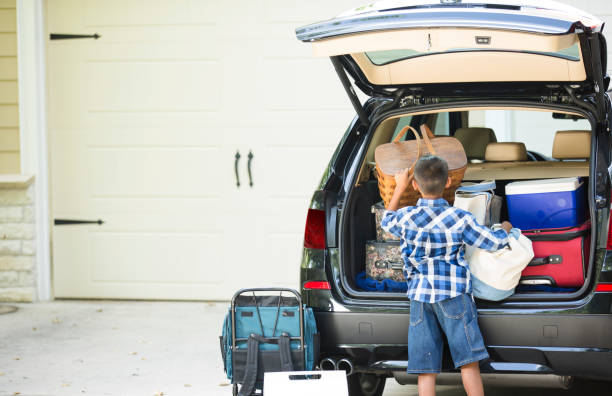 Family packs car for summer vacation. stock photo