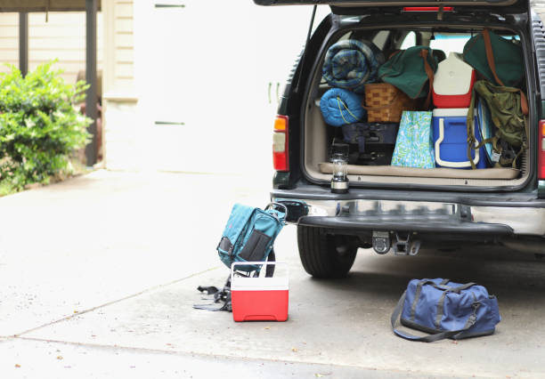Family packs vehicle for autumn vacation trip. stock photo
