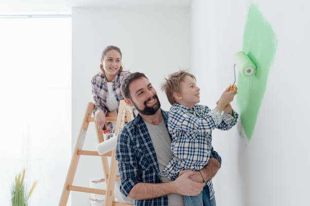 Family painting a room together - Photo