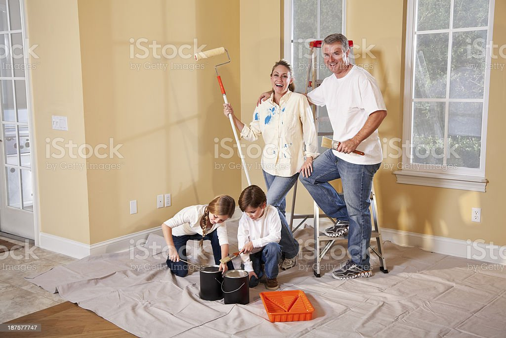 Family painting home interior stock photo