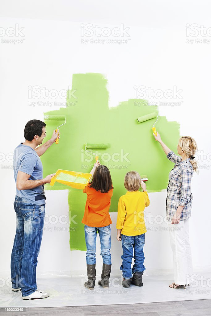 Family painting the wall. royalty-free stock photo