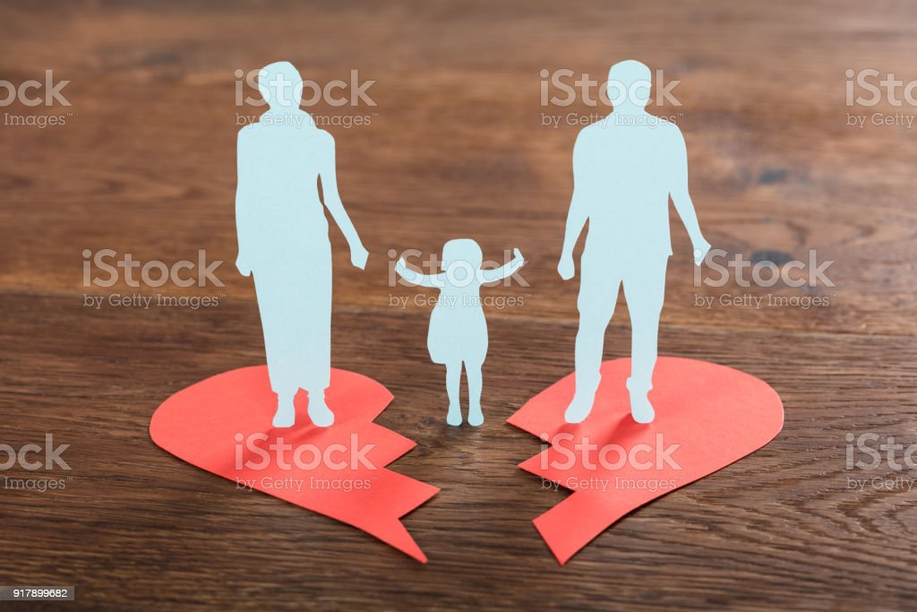 Family Paper Cut On Broken Heart stock photo
