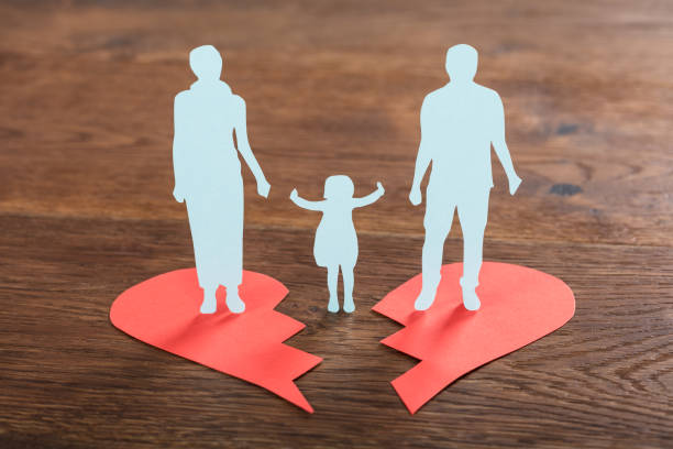 family paper cut on broken heart - separation stock photos and pictures