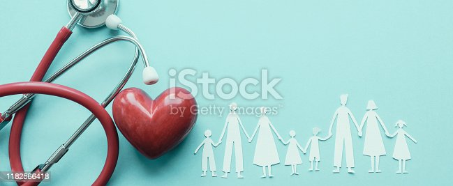 Family paper cut out with red heart and stethoscope, heart health,  family health insurance concept, World heart day, world health day, blood organ donation