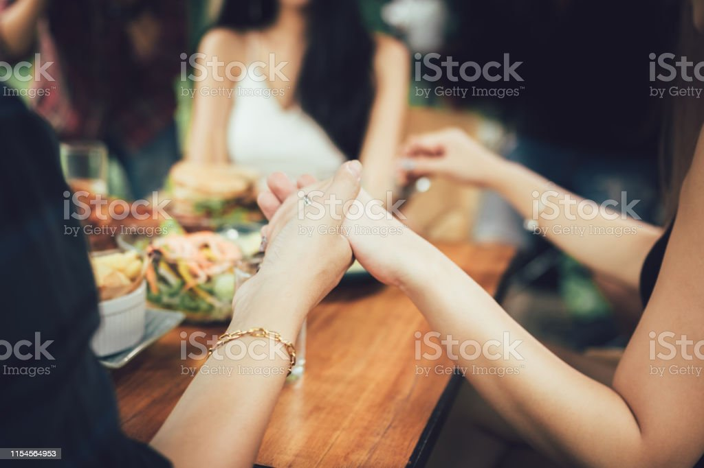 Family people praying before Thanksgiving dinner at home. Family people praying before Thanksgiving dinner at home. Adult Stock Photo