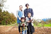 Family photo in vegetable garden