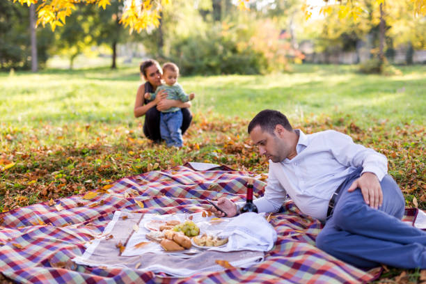 Family picnic in the woods in the fall