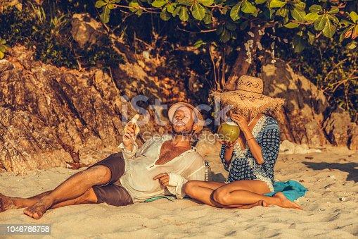 Family picnic on tropical beach