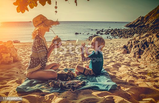 Family picnic on tropical beach