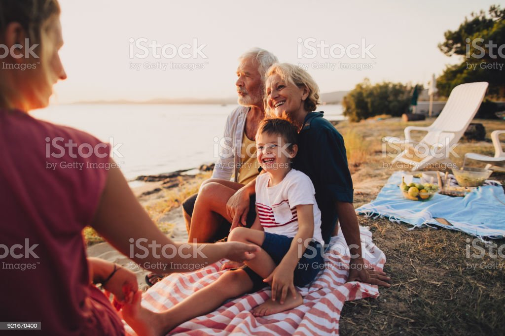 Family picnic on the beach stock photo