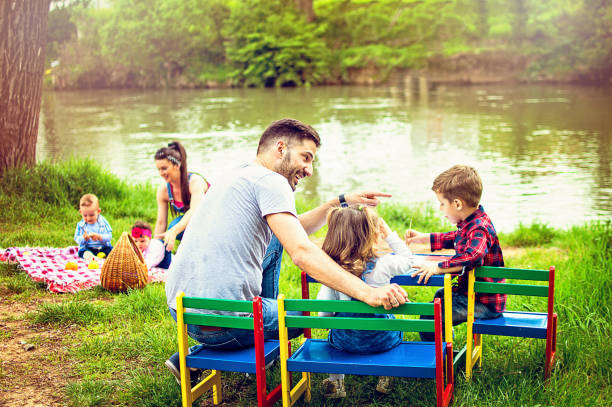 family picnic on the river - vier kinder stock-fotos und bilder