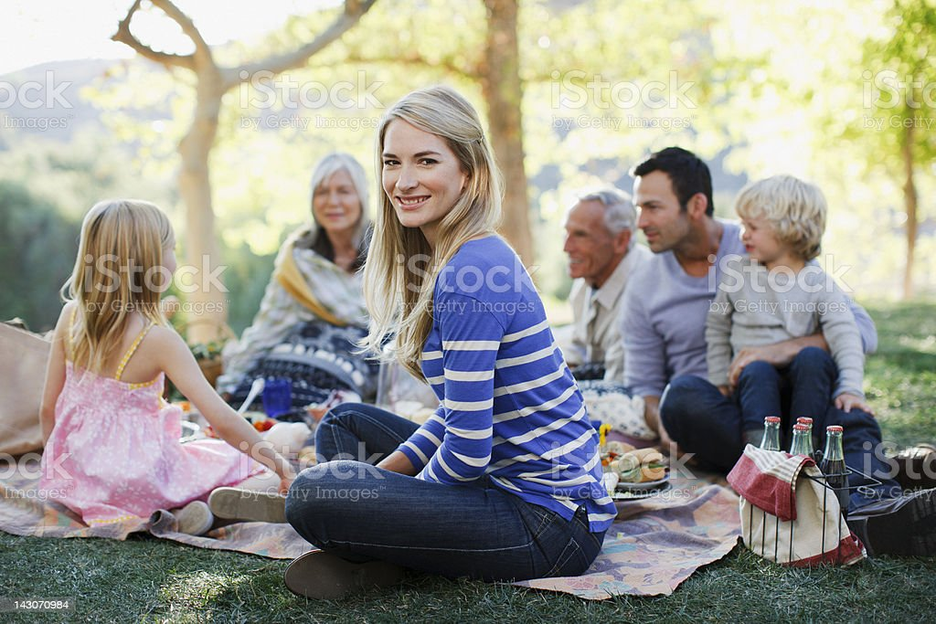 Family picnicking together on grass stock photo