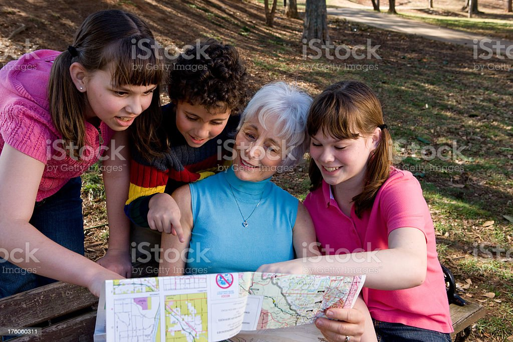 Family Plans Using A Map royalty-free stock photo