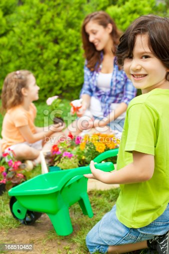 istock Family Planting Flowers Together 168510452