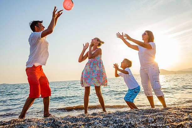Family play on beach stock photo