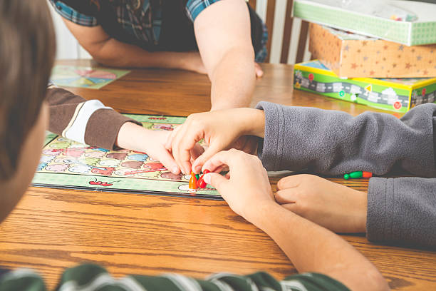 Family Playing A Board Game Together stock photo