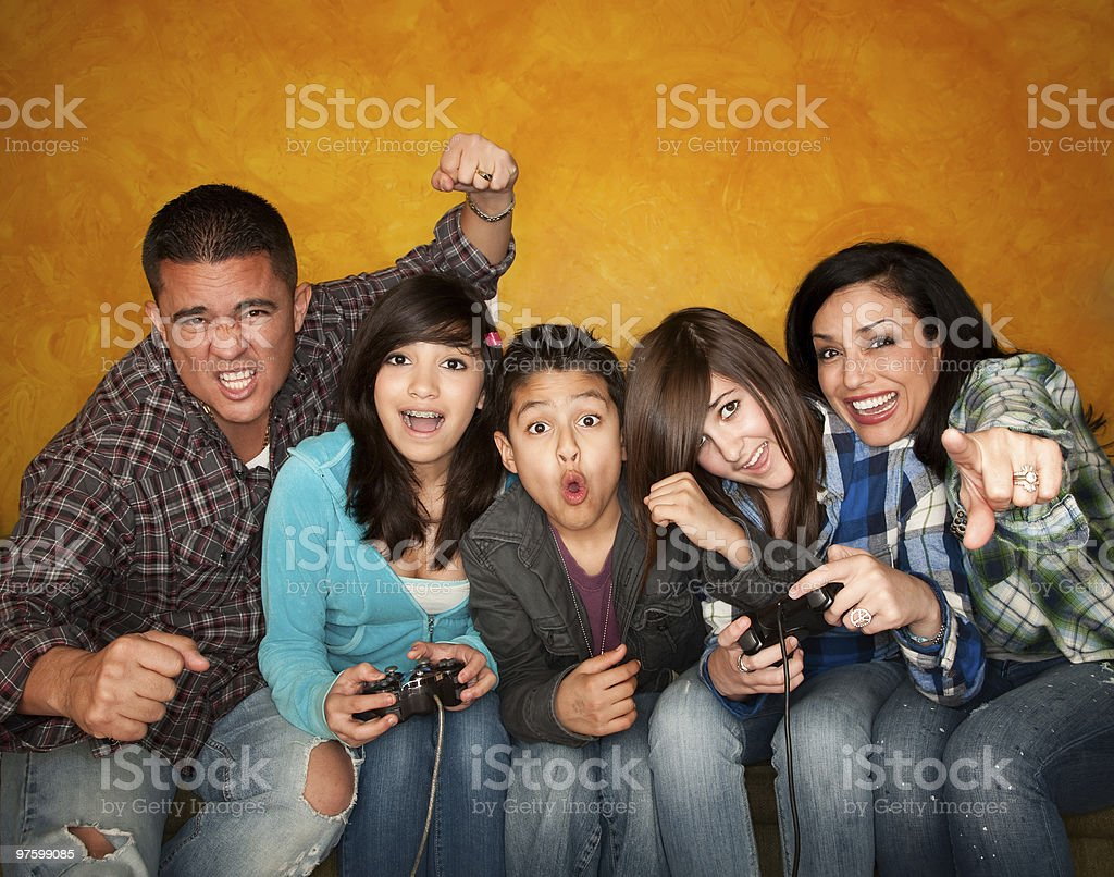 Family Playing a Video Game royalty-free stock photo