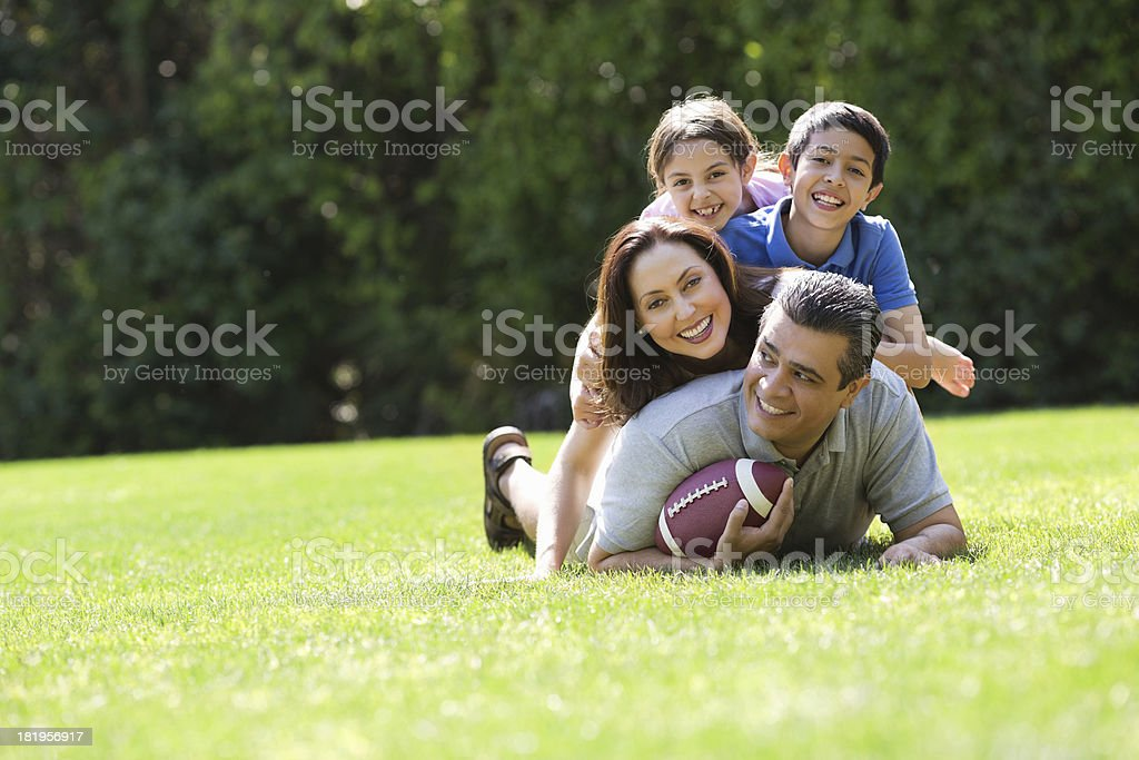 Family Playing American Football In Park royalty-free stock photo