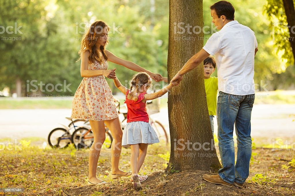 Family Playing Around the Tree. stock photo