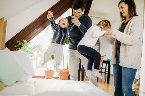 Family playing at home having good time stock photo