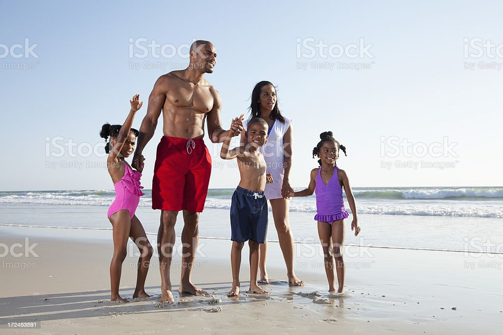 Family playing at the beach stock photo