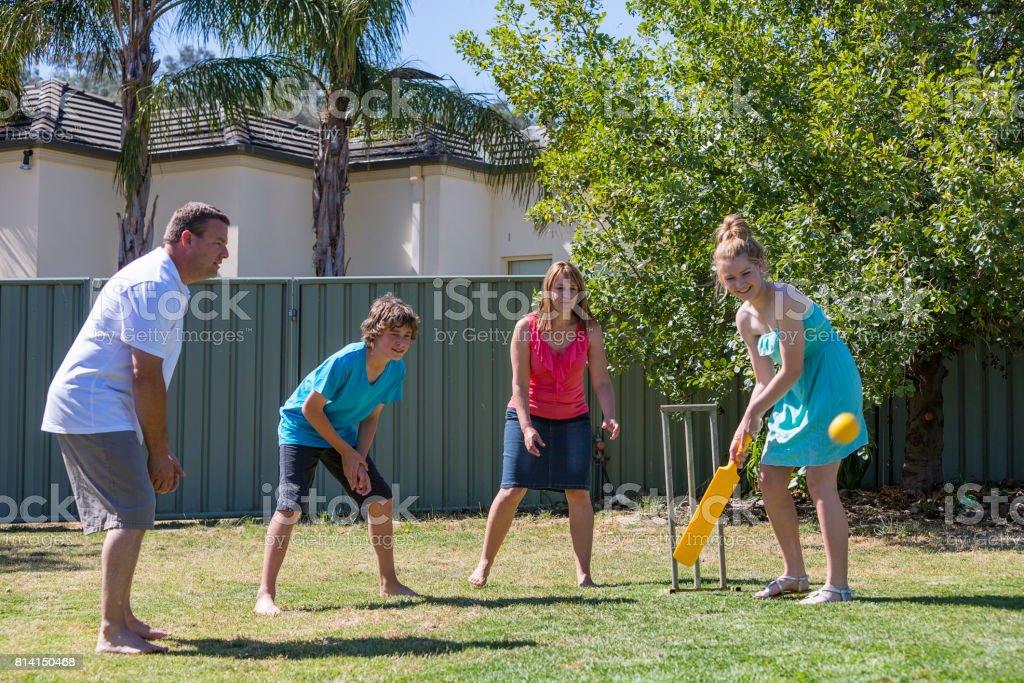 Family Playing Backyard Cricket stock photo