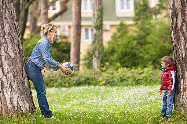 Family Playing Ball in a Park stock photo