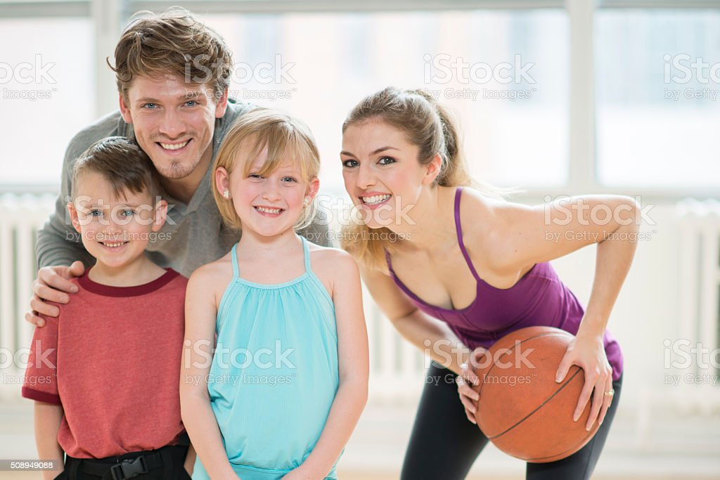 Family Playing Basketball at the Gym stock photo