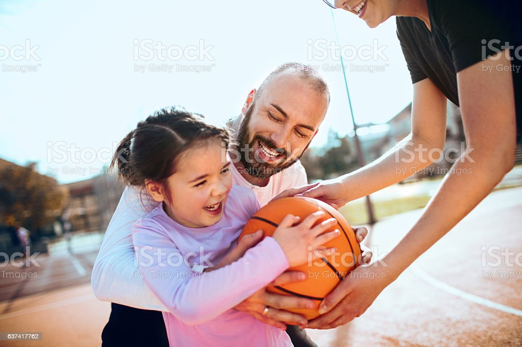 Family playing basketball stock photo