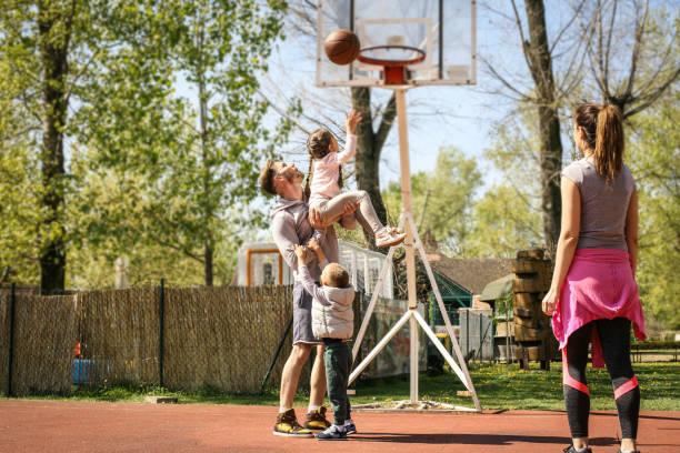 Family playing basketball. stock photo