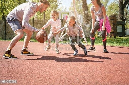 istock Family playing basketball. 681052056