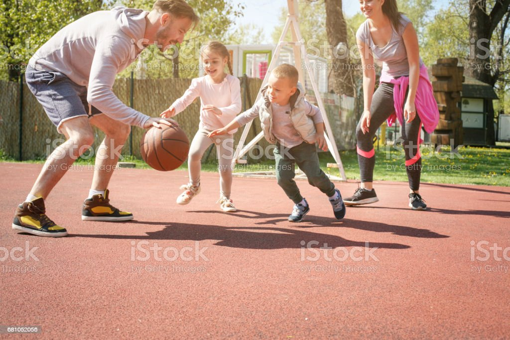 Family playing basketball. stock photo
