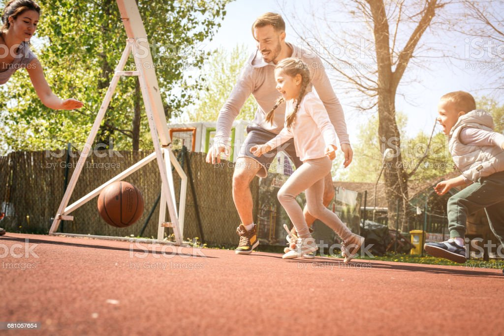 Family playing basketball. royalty-free stock photo
