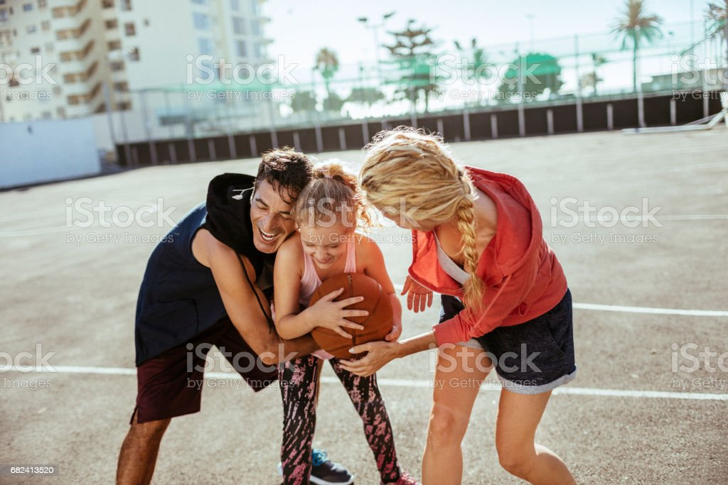 Family playing basketball royalty-free stock photo