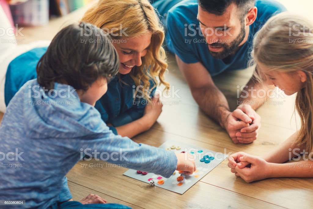 Family Playing Board Game At Home stock photo