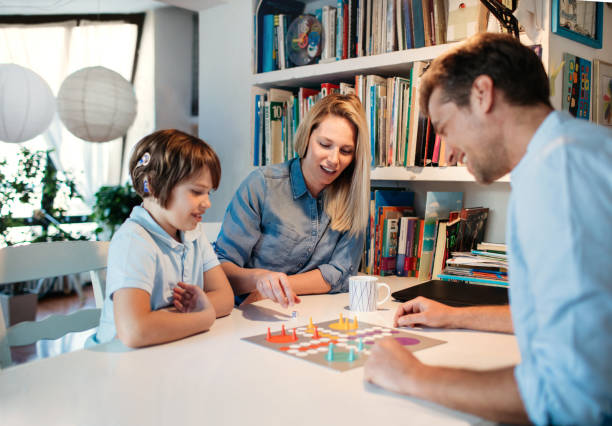Family Playing Board Game stock photo