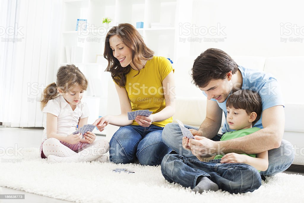 Family Playing cards at home. stock photo
