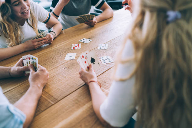 Family Playing Cards Cheerful Family Playing Cards leisure games stock pictures, royalty-free photos & images