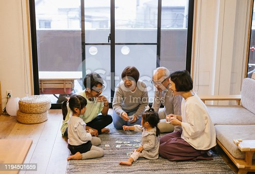 Family playing karuta cards on New Year's day
