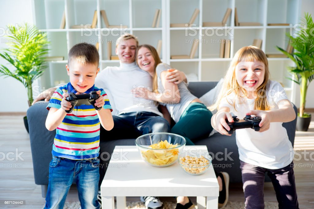 Family playing console stock photo