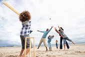 istock Family playing cricket on beach 121234315
