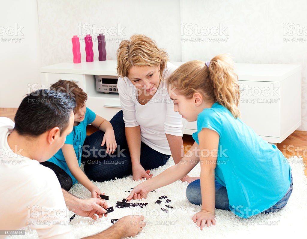 Family playing dominoes stock photo