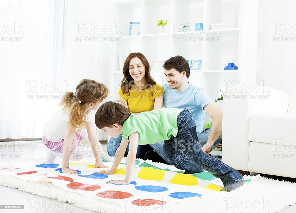 Family playing floor game. royalty-free stock photo
