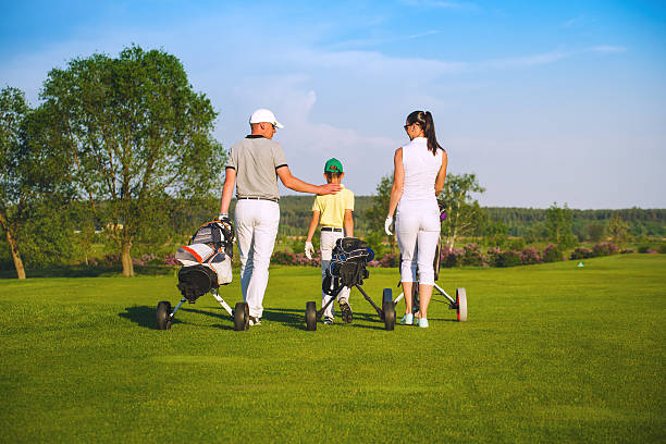 Family playing golf stock photo