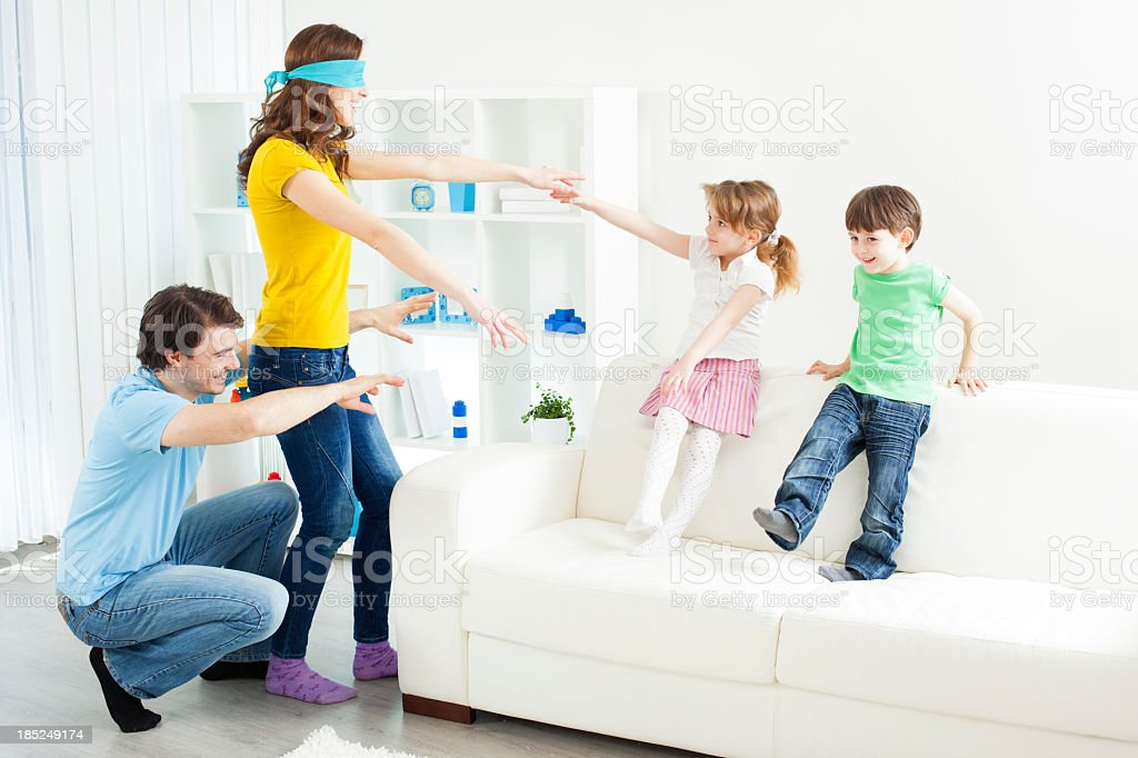 Family playing hide and seek. stock photo